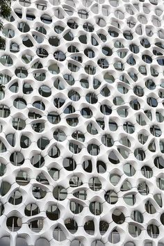 Elegant Embellishments' sculptural façade system does double duty as an air-cleaning cladding