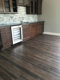 Shaw Market Square Breckenridge  |  Luxury Vinyl Plank is a great basement flooring especially by a wetbar!  |  Rustic Flooring  |  Home Bar & Entertainment Ideas