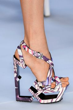 Céline Kiraro Sandals, S/S 2009 For her final effort at Céline, Croatian designer Ivana Omazic created a graffiti-printed, platform-wedge sandal with a missing-insole. With the thankless task of completing a collection after her dismissal was publicly announced, we can't blame her for showing this.