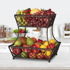 This Loop Lattice 2 Tier Rectangular Basket is a perfect catch-all, as well as a decorative accent for your kitchen counter. Handcrafted from wrought iron for long-lasting beauty even under rigorous use. The basket features an attractive loop design that will complement any decor. To clean, simply wipe with a damp cloth. Measures 14 inches high x 12 inches wide. Kitchen Cabinet Remodel, New Kitchen Cabinets, Kitchen Counters, Fruit Storage, Storage Baskets, Wire Baskets, Kitchen Furniture, Kitchen Decor, Kitchen Ideas
