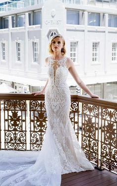 This quintessential Essense of Australia gown takes classic bridal elements, from lovely lace to a full-length train, and elevates it for the modern bride. Stunning graphic lace placed over the entire bridal gown effortlessly contours the body to flatter the figure. Negative space is thoughtfully used to accentuate the gorgeous intricacy of the lace pattern for a dramatic effect. The cascading train finishes this dress to give you the ultimate bridal moment while walking down the aisle. Tulle Wedding Gown, Bridal Gowns, Lace Wedding, Bridal Collection, Dress Collection, Wedding Dress Necklace, Essense Of Australia Wedding Dresses, Simple Gowns, Floral Lace Dress