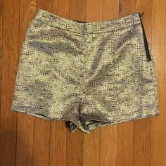 Forever 21 high wasted shorts NEVER worn! High wasted, gold and black. Very shiny in person! Side zipper Forever 21 Shorts