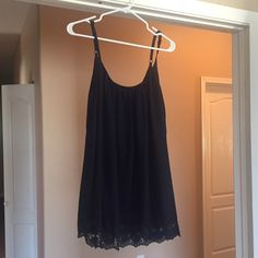 Navy blue summer dress Size small. Never worn. Color is navy blue and has cute lace detail at bottom of dress. Tobi Dresses