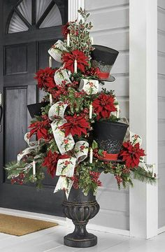 I love this topiary and urn.  Poinsettias, top hats, and gorgeous ribbon.