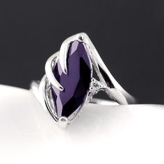 'Size 7 Marquise Cut .925  Amethyst  Ring' is going up for auction at  4am Wed, Sep 12 with a starting bid of $8.