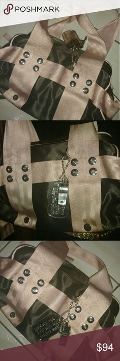 """🆕Unique Juicy Bag Juicy Couture nylon handbag   Nice Condition  Approx 16x8 Inches  Has a dog tag attached to the bag   Silver Toned Tag Says says   """"Juicy Couture for Nice Girls Who Like Stuff""""   A silver whistle is also attached   💞 Ask Me About Free Shipping 💞 Juicy Couture Bags Shoulder Bags"""