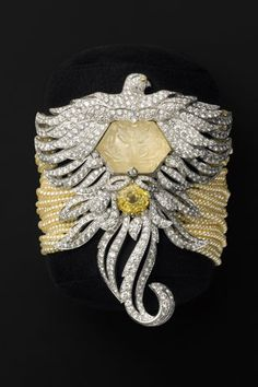 Cartier watch...closed, white gold, yellow sapphires, diamonds, pearls