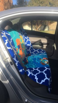 I made a back seat cover for my car out of beach towels.