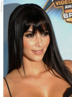 Kim Kardashian with long straight hair with bangs