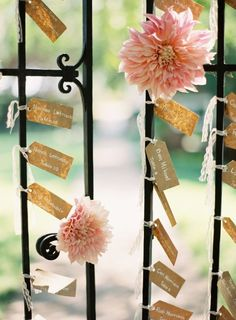 Escort cards tied up with lace to the venue's gate.