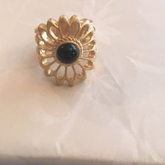 Lia Sophia flower ring Lia Sophia flower ring with black stone in the middle. Worn once. Lia Sophia Jewelry Rings
