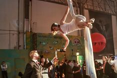 """silk aerialists who descended from the center a giant chandelier to pour champagne for guests.  Redmoon Theater's """"Revolution"""""""