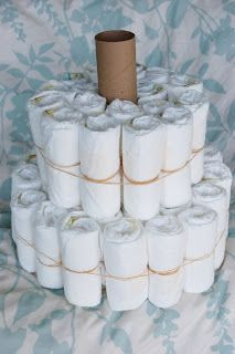 This tutorial looks like a really good one to try Alli Crafts: Craft Tutorial: How to Make a Diaper Cake