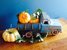 A cute vintage truck loaded with fall pumpkins!