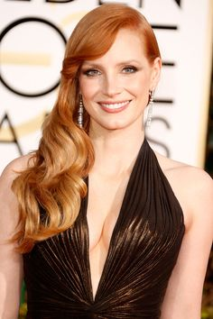 Jessica Chastain brought the sex appeal to the red carpet with a plunging neckline, va-va-voom waves and smoky gray eyeshadow winged out past her brows.