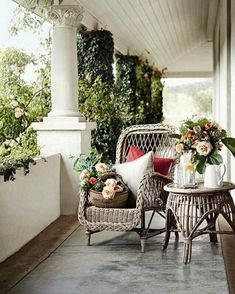 DREAMY VERANDA, Adelaide Hills, Australia. Charming out door space with creeping fig covered columns, pretty rattan furniture and bowls and baskets of David Austin roses. I know most of you are fending off snow storms but down south we are sweltering! Not sure which Australian mag this is from but probably Vogue Living, photograph by Mark Roper #outdoorinspiration #veranda #rattan #canefurniture #davidaustinroses #creepingfig #australianliving #outdoorliving #alfresco