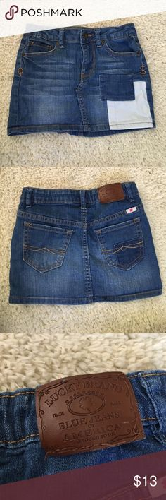Girl's Lucky Brand jean skirt with white accent. Girl's Lucky Brand jean skirt with white accent. Small bit of stitch came out of brand logo. Only worn once for a photo shoot. Super cute and stylish! Lucky Brand Bottoms Skirts