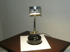 Desk lamp made from used motorcycle and scooter parts. Uses a LED light an goose neck to finalize piece