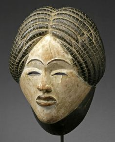 Africa | Mask from the Punu/Lumbo people of Gabon | Wood, blackened and kaolin | Collected prior to World War II