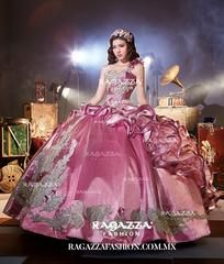 Beautiful and timeless, fall in love with this beaded strapless 3-piece gown by Ragazza Fashion Aura Collection Style Number B74-374 during your Quinceanera party or for any formal event. This beautiful Sweet 15 ball gown features a strapless sweetheart neckline, gold beaded embroidery, gold embroidery, long A-line skirt, embellished peplum, and a lace-up back. For $150, you can order a mini skirt, which gives you an amazing second look during your party.  En Espanol: Elegante bordado…