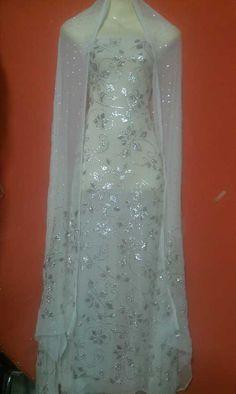 A beautiful Dress of Mukesh work called Chandi Patti.  http://www.thetraditionalshop.com