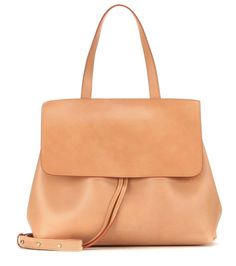 Mansur Gavriel - Lady leather shoulder bag - Mansur Gavriel's 'Lady' shoulder bag is a sleek, structured piece that will imbue any look with a timelessly chic quality. The smooth tan leather piece is given the label's signature pop of colour with a light pink interior. Tote it along to business meetings or weekends in the city over your shoulder or in the crook of your arm. seen @ www.mytheresa.com