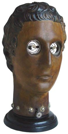 Anatomical model head for eye surgeon training - the cavities hold cadaver eyes.