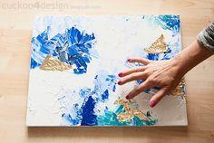 randomly apply gold foil to acrylic paint on canvas