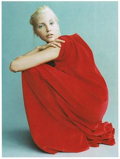 Red, floor-length dress, blue background