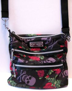 Black, pink, green, and purple skull-print crossover purse #skulls from Betsey Johnson. This is a great concert bag - cross-body for security, and big enough for a compact camera, phone, wallet, ID, and ear protection!
