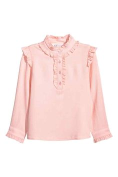 Long-sleeved blouse in a viscose weave with a small stand-up collar, frill-trimmed button placket and decorative frills over the shoulders and at the cuffs. Stylish Dresses, Elegant Dresses, Girls Fashion Clothes, Fashion Outfits, Blouses Roses, Mode Kawaii, Sleeves Designs For Dresses, Blouse Designs, Blouses For Women