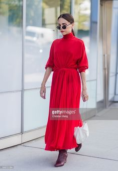 Evangelie Smyrniotaki  wearing red dress seen in the streets of Manhattan outside Delpozo during New York Fashion Week on September 13, 2017 in New York City. (Photo by Christian Vierig/Getty Images)