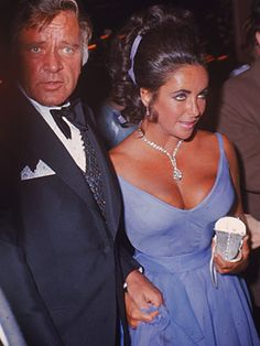 Elizabeth Taylor with Richard Burton, Academy Awards 1970. The dress: A deep blue-violet chiffon Edith Head gown with a plunging neckline and a ruffled, slit skirt. Oh, by the way, Elizabeth is wearing the Taylor-Burton diamond.