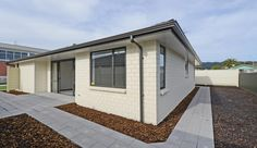 This home, built for the is designed to suit a range of people as they age. The homes in Upper Hutt, NZ, were created by the Dugdale Trust. Pocket Neighborhood, Pathways, Car Parking, The Neighbourhood, Trust, Range, House Design, Homes, Building