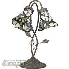 Tiffany Tafellamp Zalani Flower  Fleurige tafellamp met dubbele kap. De tiffany kapjes hebben een bloemenmotief. Helemaal met de hand gemaakt van echt Tiffanyglas. Dit originele glas zorgt voor de warme uitstraling. Met bronskleurige voet met blaadjes. Met 2x kleine fitting (E14). Met schakelaar aan het stroomsnoer. Afmetingen: Hoogte: 47 cm Breedte: 34 cm Diepte: 28 cm