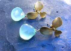 Matte gold plated orchid stud earrings with ocean spray chalcedony briolettes