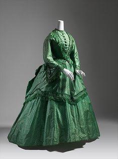Dress Date: ca. 1870 Culture: British Medium: silk Dimensions: Length at CB (a): 21 1/2 in. (54.6 cm) Length at CB (b): 46 in. (116.8 cm) Length at CB (c): 31 1/2 in. (80 cm) Credit Line: Catharine Breyer Van Bomel Foundation Fund, 1980