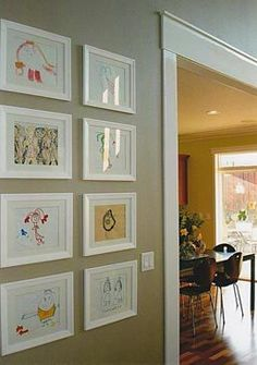 displaying Claire's art in the living room- courtesy of Apartment Therapy