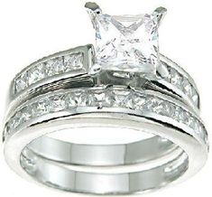 Traditional bridal style and outstanding craftsmanship at its best. The hand set 1 carat princess cut CZ stone in the engagement ring is faceted to give the clarity and depth of a multi-thousand dollar diamond. The precision fit solid sterling silver bands are heavily plated in tarnish free rhodium and finished off with perfectly coordinated channel set CZ accent stones. $36.99
