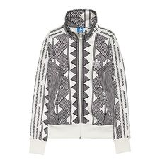 The bold graphic pattern on this women's Mexkumrex Firebird Track Top is inspired by the traditional body paintings of Amazonian Indians. The track jacket has a high stand-up collar and solid ribbing around the cuffs and hem.