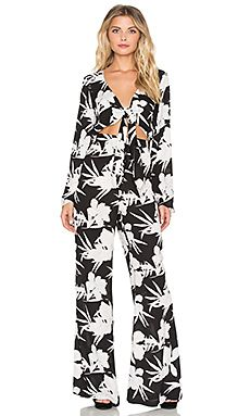 7f0339e2432b Poly blend Dry clean only Waist cut-out with tie closure Hidden side zipper  closure Style No. Show Me Your Mumu Jaelynn Jumpsuit in Lily Collins ...
