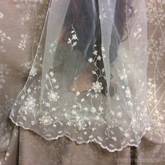 This is a simple rolled edge veil. It measure 27 inches in length from top to bottom.  Since the veil is HAND MADE when you place your order, Your veil