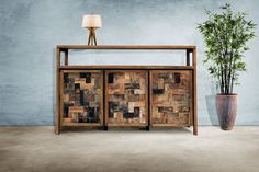 Recycled Teak Media Center.  Perfect for use as a media center or TV stand! The open top shelf is designed to house audio/video components such as cable boxes, media players and home theater receivers while the cords tuck conveniently out of view behind. #teak #rusticfurniture #homedecor #furniture #mediacenter #tvstand