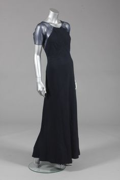 Jean Patou navy cloque silk evening gown, early 1930s, bias cut with triangular seam to waist with ties to the side, organza sleeves and low back panel, -