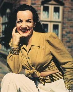 Carmen Miranda in mustard yellow blouse