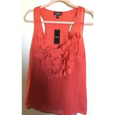 Bebe orange-red tank top Size: Large Bebe orange-red tank top, 100% silk, NWT but has a small stain near the left armpit- see third picture. bebe Tops Tank Tops