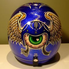 blue pinstriped helmets with eyeball in center