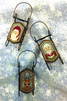 The Sled Heads sled ornaments presents us with Santa Claus, Mrs. Claus, and their ever faithful reindeer! Quick and simple to stitch for an easy yet sweet gift or ornament!