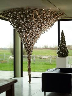 beautiful upside-down tree form sticks and christmas balls - (re)Pinned by Idea Concept Design.nl