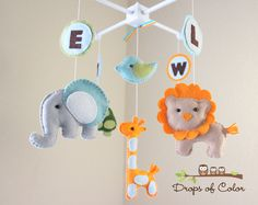 "Baby Crib Mobile - Baby Mobile - Nursery Elephant, Giraffe, etc Mobile ""ABC Baby Animals"" (You can pick your colors, animals and letters). $90.00, via Etsy."